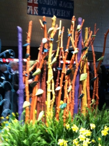 A collection of painted sticks with ceramic leaves that served as the backdrop for one display/