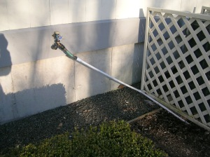 The line runs under the lawn up to the house, where it connects to the back faucet.
